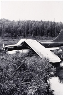 Bush plane that will never take off again.Triangulation party of Norman Sylar