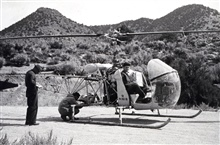 Loading for a drop on Owens Peak.Triangulation party of Lorne G. Taylor