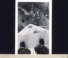 Looking down from the top of a 50-foot tower.Triangulation party of Wilbur Porter