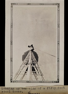 Looking up the side of a 50-foot tower.Triangulation party of Wilbur Porter