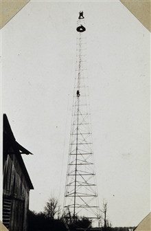 A 159-foot tower.Note men on top and man climbing up