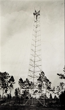 Building the tower at Station Hunter.Photo #1 of sequence.Triangulation party of Kenneth Crosby