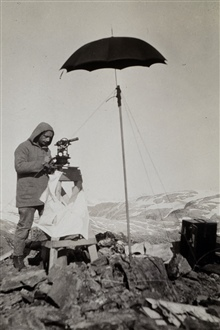 Small umbrella lashed to alpenstock - shading instrument from sun.Triangulation party of William M. Scaife