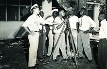 Instructing Liberians in use of survey instruments.Combined operations party of George Morris