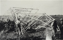 A 90-foot tower wrecked by a storm.Triangulation party of E. O. Heaton