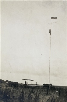 John F. Hayford observing from 60' reconnaissance pole.On 98th Meridian Survey.Checking for intervisibility between stations.Helping plan for necessary height of tower at station