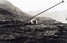 Shore station Shoran antenna being raised.First electronic navigation antenna ever raised by C&GS.;Party off of EXPLORER.Photo No. 2 of sequence