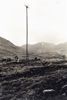 Mast and antenna system for Shoran installation.First electronic navigation antenna ever raised by C&GS.;Party off of EXPLORER.Photo No. 4 of sequence