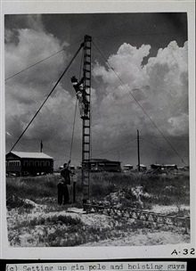 Setting up a Raydist tower.Preparing the gin pole - basically a large lever arm.Party off of wire drag vessels WAINWRIGHT and HILGARD.Photograph #2 of sequence
