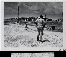 Setting up a Raydist tower.Ready to erect tower.Party off of wire drag vessels WAINWRIGHT and HILGARD.Photograph #3 of sequence
