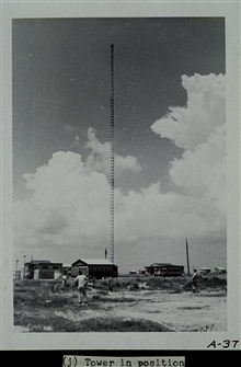 Setting up a Raydist tower.Tower in position and ready to transmit.Party off of wire drag vessels WAINWRIGHT and HILGARD.Photograph #7 of sequence