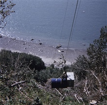 Bringing Shoran gear up a cliff for shore camp.Operations off of SURVEYOR