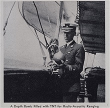 Holding RAR bomb.In 1944 issue of the magazine The Military Engineer