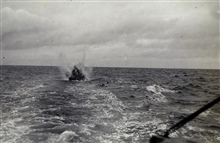 RAR bomb being exploded astern of GUIDE.North shore of Unimak Island