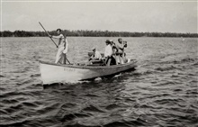 Using sounding pole to measure depth in shallow water.Combined operations party of B. H. Rigg