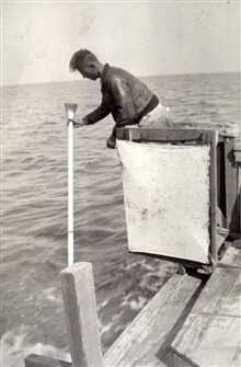 Using sounding pole to measure depths.Combined operations party of William D. Patterson