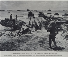 Amphibious landing beach on Tinian at H+5 hours.Note survey crew on left already beginning work for artillery survey