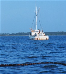 Menhaden fishing - mother vessel as seen over the floats on the net
