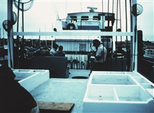 Anglers getting equipment ready aboard charter (CPFV) vessel