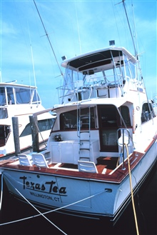 A recreational fishing boat at the Mystic River Marina