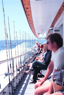 Underway on a headboat - poles lined up and ready for the next fishing stop