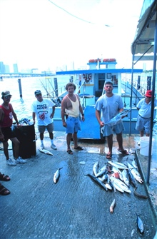 Proud fisherment with catch of King and Spanish mackerel