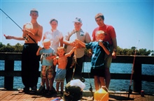 Three generations of fishermen enjoy a day at the Bayport Pier.