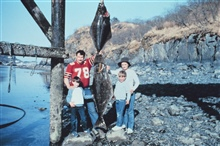 Family of anglers with nice Pacific halibut