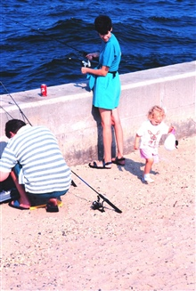 Fishing - a family affair.  Starting a lifelong love affair with fishing at atender age.  Fishing from the seawall at Manasquan Inlet.