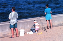 Mom, Dad, and Baby enjoy a day of fishing at Manasquan Inlet.
