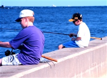 Buddies for life fishing along the seawall at Manasquan Inlet