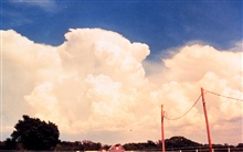 Building line of cumulonimbus thunderstorms.View is from behind storms during early stages of development.