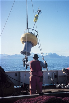 Deploying a small oceanographic buoy off the MILLER FREEMAN
