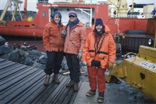 Polly Penhale (NSF), Rennie Holt and AMLR scientists at Palmer Station withR/V Polar Duke in background.