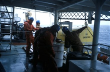 Preparing to deploy a piece of oceanographic equipment aboard the NOAAShip Surveyor.