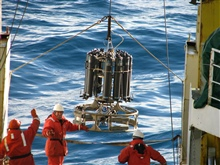 The crew of the R/V Yuzhmorgeologiya deploys a CTD from the stern.