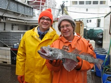 Proud Antarctic ichthyologists with their catch, a toothfish.