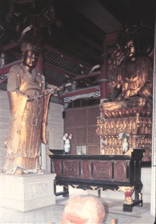 Buddhist temple with decorative metal sculpture