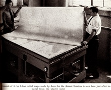 One of thousands of 4- X 6 foot relief models made by Aero for the armed forces is seen here just after removal from the plaster mold.In: Wilson, Don C. 1949. Production of Plastic Relief Maps in Surveying andMapping, Vol. IX, no. 3, pp. 183-186.