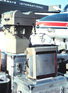 Photogrammetric camera Wild RC-8 and other associated equipment ready forinstallation on Turbocommander at Dulles International Airport.