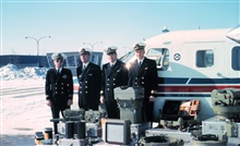 Lieutenant F. D. Moran, LCDR Frederick H. Grammling, Lieutenant Robert C.Westphall, and Lieutenant Robert Franklin at Dulles International Airport.Preparing for photogrammetric mission.