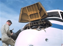 Performing maintenance on NOAA de Havilland Buffalo N13689.