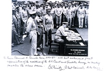 Copy of Admiral Chester Nimitz signing Japanese surrender document at the end of World War II.  Admiral Nimitz wrote a personal message to Rear Admiral H.Arnold Karo:  ... with best wishes and great appreciation of the assistance ofthe U. S. Coast an