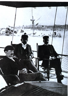 Unidentified officers sitting on the stern of the Coast and Geodetic Survey ShipBACHE in Havana Harbor on February 16, 1898.  The night beforethe Battleship MAINE had sunk in Havana Harbor.  The BACHE was working atthe Dry Tortugas and upon word of t