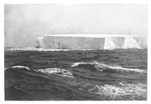 A small tabular iceberg seen during a northeast storm on December 19, 1898.On the left is a wave striking the berg.  Height: 34 meters.  Length 119 meters. P. 208.In: Aus den Tiefen des Weltmeeres by Carl Chun, 1903. Call No. Q115.V15 1903.