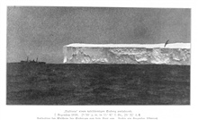 Ice berg seen on December 7, 1898.  The VALDIVIA shows the scale of these hugetabular icebergs.  The iceberg was at 55 47 South Latitude, 29 32 East Longitude.  An albatross is flying on the right. P. 219.In: Aus den Tiefen des Weltmeeres by Carl Chu