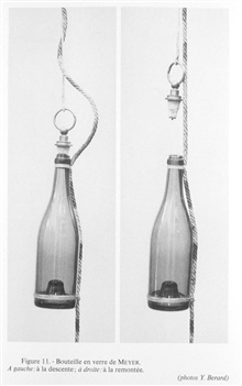 Figure 11.  Meyer glass water sampling bottle invented by Dr. Adolph Meyer ofthe Commission of Kiel and used on the POMMERANIA for studies in the Baltic Sea in 1871.  This sampling bottle was used in surface layers of water to about 10meters.  Left:
