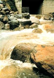 A high-flow event as water rushes over the newly constructed fish pools.