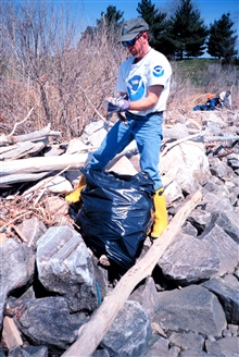 Roger Griffis of NOAA assists in the clean-up at Ft. McHenry, MD.