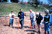 Glenn Page, the Conservation Director for the National Aquarium in Baltimore,instructs volunteers in planting techniques and in using a dibble.
